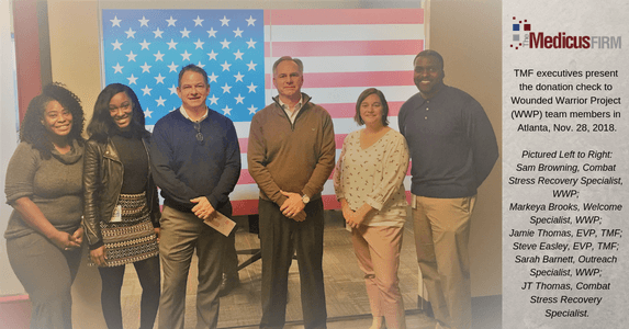 TMF Donates to Wounded Warrior Project for Annual Holiday Charity